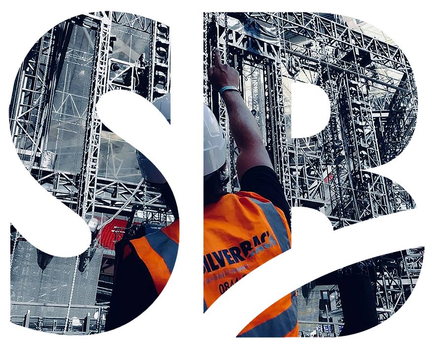 Crew member with hard hat pointing upward
