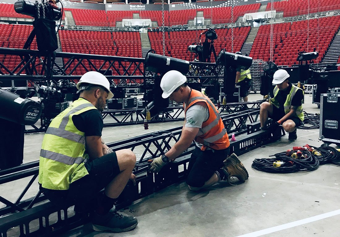 Silverback team joining truss together in stadium