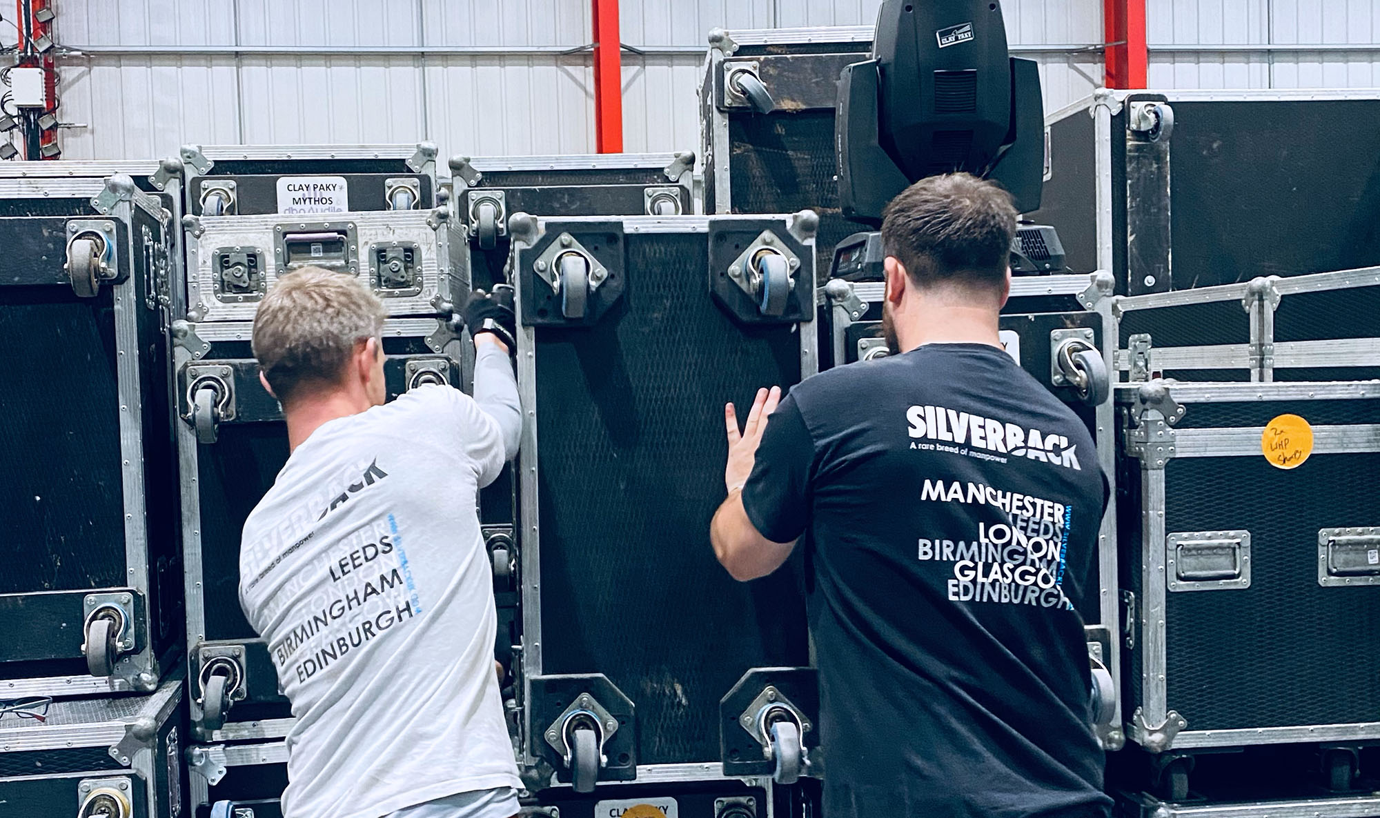 Two Silverback crew lifting large box together