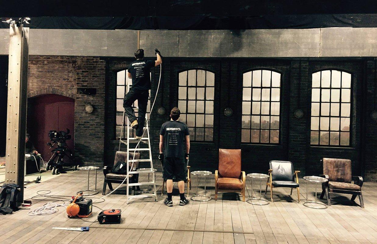Two Silverback crew members building Dragon's Den TV set