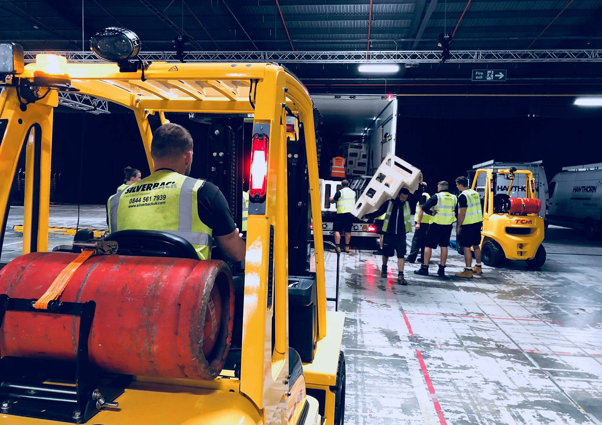 Silverback team unloading truck with forklift